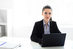 Young beautiful business woman with laptop in the office Royalty Free Stock Photography