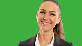 Young beautiful business woman looking at the screen smiling on a green background with alpha channel. close up. 43 stock footage