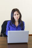Young beautiful business woman in office working on white laptop Stock Photo