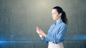 Young beautiful business woman with phone in her arms Royalty Free Stock Image
