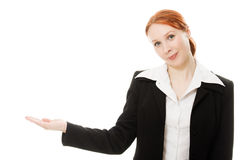 A young beautiful business woman pointing. At copyspace Stock Image