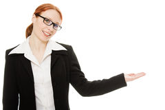A young beautiful business woman pointing. At copyspace on a white background Royalty Free Stock Images