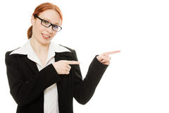 A young beautiful business woman pointing. At copyspace on a white background Royalty Free Stock Photos