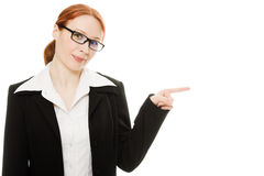 A young beautiful business woman pointing. A young beautiful business woman Royalty Free Stock Images