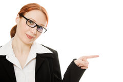 A young beautiful business woman pointing. At copyspace on a white background Royalty Free Stock Photo