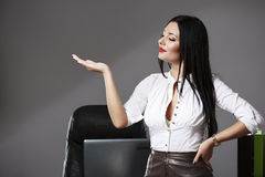 Young beautiful business woman pointing at copyspace. A young beautiful business woman pointing at copyspace Royalty Free Stock Photo