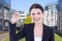 Young beautiful business woman real estate agent showing visitin Stock Photo