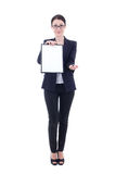 Young beautiful business woman showing empty blank clipboard and. Giving pen isolated on white Stock Images