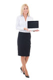 Young beautiful business woman showing laptop with copyspace iso. Lated on white background Stock Photography