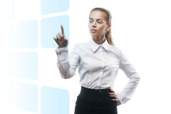 Young beautiful business woman showing something. Over white background Royalty Free Stock Photos