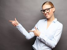 Young beautiful business woman showing something or copyspase fo. Happy smiling young beautiful business woman showing something or copyspase for product or sign Royalty Free Stock Image