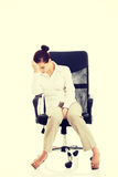 Young beautiful business woman sitting on a chair. Stock Images