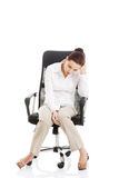 Young beautiful business woman sitting on a chair. Stock Photo