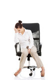 Young beautiful business woman sitting on a chair. Stock Image