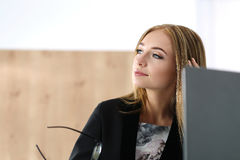 Young beautiful business woman sitting at her working place Royalty Free Stock Images