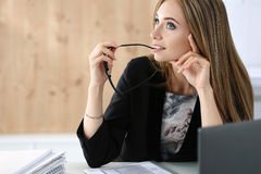 Young beautiful business woman sitting at her working place Royalty Free Stock Photography