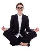 Young beautiful business woman sitting in yoga pose isolated on Stock Photography