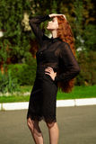 Young beautiful business woman standing outdoor in black suit Stock Image