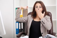 Young beautiful business woman suffering stress working at office asking for help feeling tired stock photo