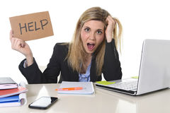Young beautiful business woman suffering stress working at office asking for help feeling tired. Young beautiful business woman suffering stress working at Royalty Free Stock Images