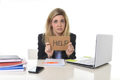 Young beautiful business woman suffering stress working at office asking for help feeling tired Royalty Free Stock Images