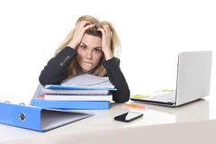 Young beautiful business woman suffering stress working at office computer desk load of paperwork Stock Photo