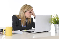 Young beautiful business woman suffering stress working at office frustrated and sad Stock Photography