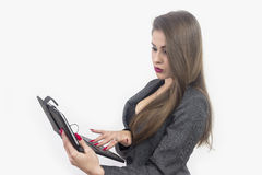 Young beautiful business woman with tablet in office Stock Image