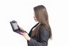 Young beautiful business woman with tablet in office Royalty Free Stock Images