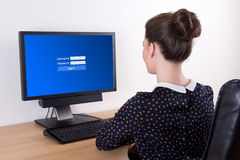 Young beautiful business woman using pc with login panel on scre Stock Photography