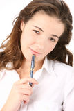 Young Beautiful Business Woman With A Pen Stock Photo