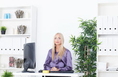Young beautiful business woman working with computer Royalty Free Stock Image