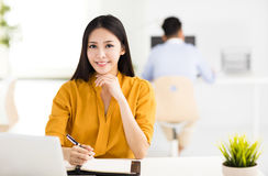 Young beautiful business woman  working in office Stock Images