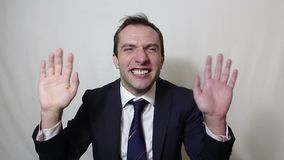 Young beautiful businessman in blue suit smiling and waving her hand greeting customers. Portrait on a white background stock footage