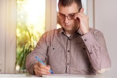 Businessman with glasses working in the modern office royalty free stock image