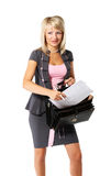 Young beautiful businesswoman. Young beautiful girl, a businesswoman with a briefcase on the white background Stock Photo