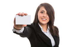Young beautiful businesswoman with blank business card. Isolated Royalty Free Stock Photos