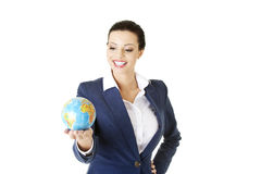 Young beautiful businesswoman holding the globe Royalty Free Stock Photos