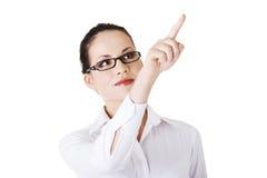 Young beautiful businesswoman making choose Royalty Free Stock Image
