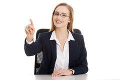Young beautiful businesswoman making choose on abstract screen Stock Photos
