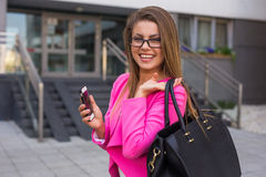 Young beautiful businesswoman with mobilephone after work Royalty Free Stock Image