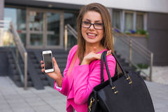 Young beautiful businesswoman with mobilephone after work Royalty Free Stock Photography