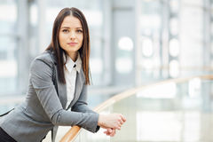 Young Beautiful Businesswoman in Office Building Royalty Free Stock Photo