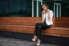 Young beautiful businesswoman outdoors Royalty Free Stock Photo
