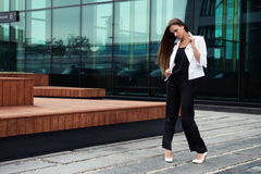 Young beautiful businesswoman outdoors Stock Images