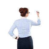 Young beautiful businesswoman with pen writing whiteboard Stock Images