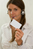 Young beautiful businesswoman with a plastic card Stock Image