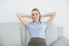 Young beautiful businesswoman relaxing sitting on couch in her office Stock Photos