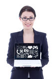 Young beautiful businesswoman showing laptop with multimedia ico Royalty Free Stock Photography