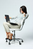 Young beautiful businesswoman sitting on the office chair Stock Photo